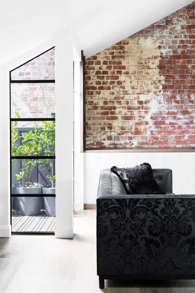 black-elegant-sofa-and-exposed-brick-wall-home-decor